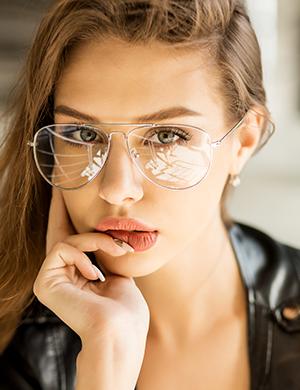 A pretty brunette wearing glasses